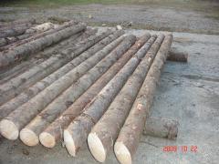 Peeled wooden poles