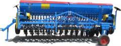 Semanatoare universala purtata cu brazdare dublu disc, fertilizator si transportor pe lung SUP 32 DK