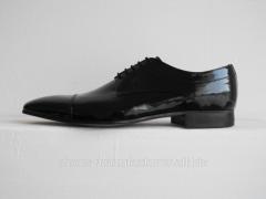 Chaussures d'hommes travaillees a la main