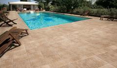 Ceramic tile for swimming pools