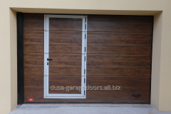 Garage doors with pedestrian kit